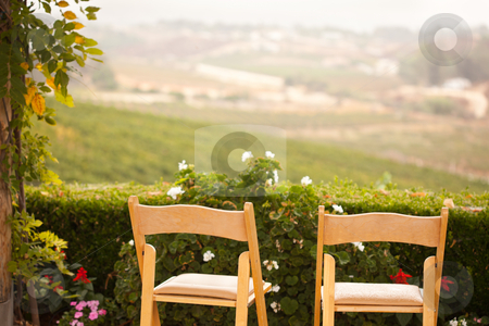 Patio Chairs Overlooking the Country stock photo, Patio Chairs and Foliage Overlooking the Country. by Andy Dean