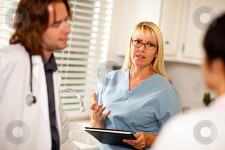 Doctors and Nurses Having Conversation stock photo, Doctors and Nurses Having A Casual Conversation in The Office. by Andy Dean