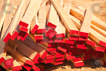 Abstract Stack of Construction Wood stock photo, Abstract Stack of 2x4 Construction Wood with Red Painted Ends. by Andy Dean