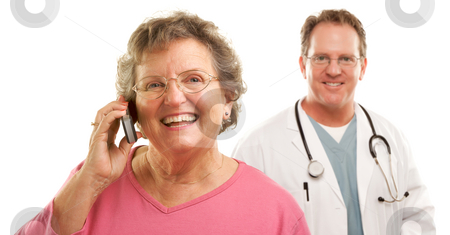 Happy Senior Woman Using Cell Phone with Male Doctor Behind stock photo, Happy Senior Woman Using Cell Phone with Male Doctor or Nurse Behind Isolated on a White Background. by Andy Dean