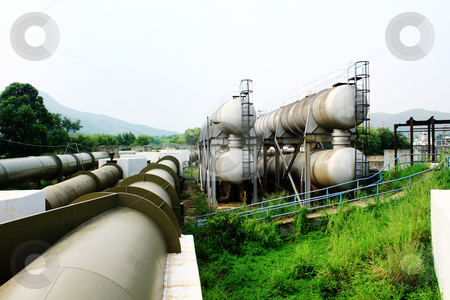 Oil tanks and pipes  stock photo, Oil tanks and pipes outdoor at day by Keng po Leung