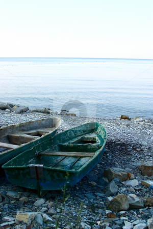 The old boats  stock photo, The old boats on the sea coast by Alex Varlakov