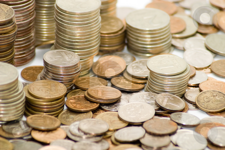 Coins stock photo, Piles of coins. The concept of cash, savings, finance and business by Alex Varlakov