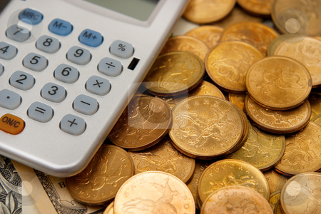 Calculator and coins stock photo, Calculator and coins. The concept of money, finance and savings by Alex Varlakov