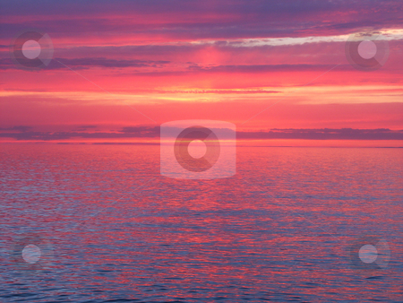 Lake Superior Sunset stock photo, Beautiful pink colors reflect off Lake Superior in northern Michigan. by Jason Ross