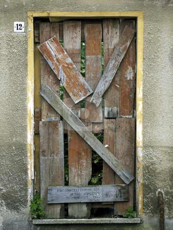 Door-nailed and blocked up stock photo, Door in an old house - blocked up and nailed by Heike Jestram