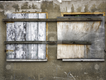 Windows boarded up and nailed stock photo, Windows in an old  house - barricaded and nailed by Heike Jestram