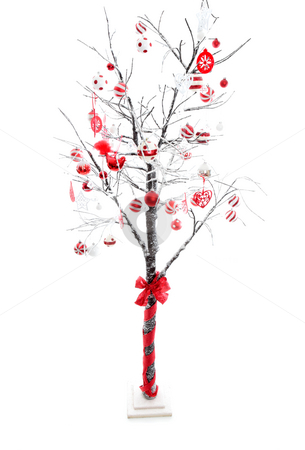 Decorated Christmas Tree stock photo, Snow covered branches of a winter deciduous tree carry red, white, silver Christmas baubles and decorations.  White background suitable for copy. by Leah-Anne Thompson