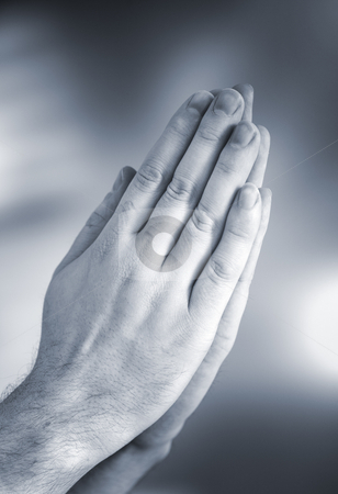 Prayer stock photo, Hands clasped together for a prayer by Stocksnapper