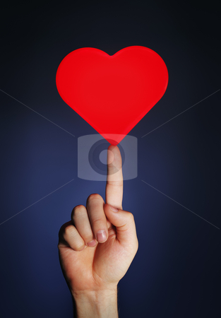 Easy Love stock photo, Man holding a glowing red heart on his fingertip by Stocksnapper