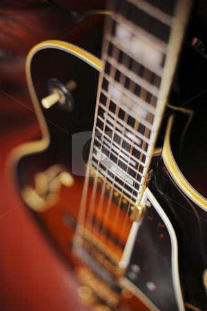 Guitar stock photo, Semi-acoustic jazz electric guitar in closeup. Short depth of field by Stocksnapper