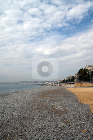 Nice France Beach stock photo, The sandy and rocky beach in Nice, France by Kevin Tietz