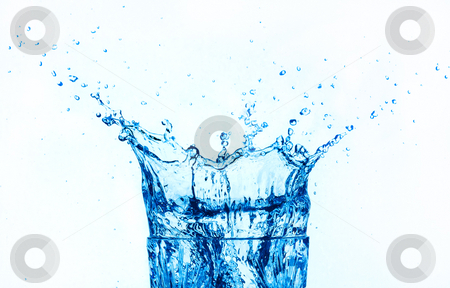 Blue water splashing isolated on white background. stock photo, Blue water splashing on glass, isolated on white background. by Pablo Caridad
