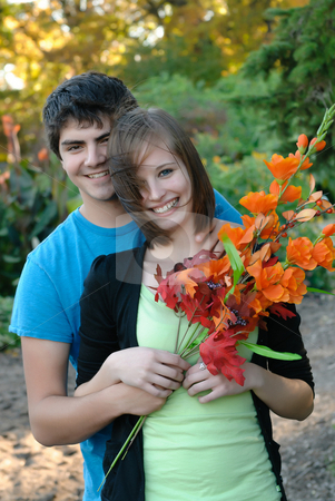 Teenage Couple stock photo, A young couple smiling during the fall by Richard Nelson