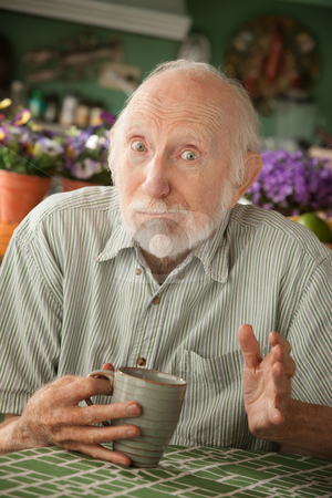 Senior man with mug stock photo, Senior man at home with coffee or tea by Scott Griessel