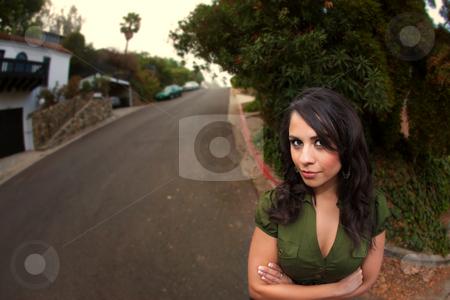 Pretty Latina Woman stock photo, Fisheye Shot of Pretty Latina Woman Standing on Street Outdoors by Scott Griessel