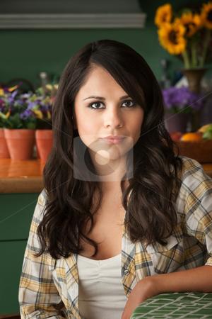 Beautiful Latina Woman stock photo, Beautiful Latina Woman at table in Kitchen by Scott Griessel