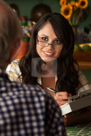 Social worker in home with elderly man stock photo, Latina social worker or home care provider with elderly man by Scott Griessel