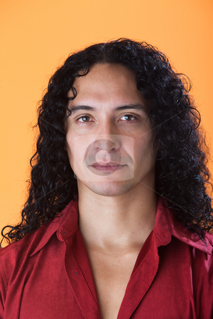 Handsome man with strong features stock photo, Handsome man with strong features and long curly hair by Scott Griessel