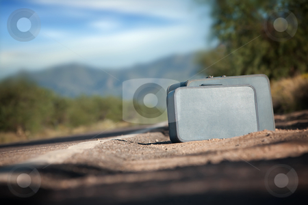 Suitcases stock photo, Suitcases by the side of a desert road by Scott Griessel
