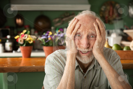 Concerned elder stock photo, Concerned senior man at home in his house by Scott Griessel