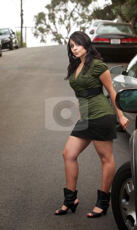 Pretty Hispanic Woman Waiting stock photo, Pretty Brunette Hispanic Woman Waiting Outdoors on Street by Scott Griessel