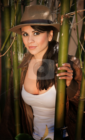 Pretty adventurer stock photo, Pretty adventurer in thick green bamboo forest by Scott Griessel
