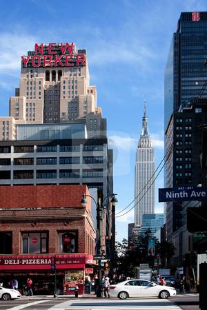 New York street scene stock photo, New York City Manhattan 34th street scene with the landmark New Yorker Hotel and Empire State building. by Paul Hakimata
