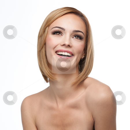 A beautiful smile with natural make-up stock photo, A portrait of a young, blonde woman, smiling and looking up, on white background by dan comaniciu