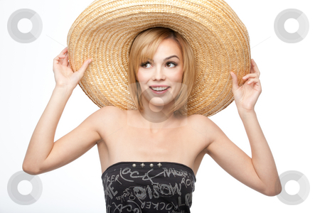 Young woman with a sombrero hat stock photo, A portrait of a young, blonde woman, holding a somnrero on her head with both her hands and smiling by dan comaniciu