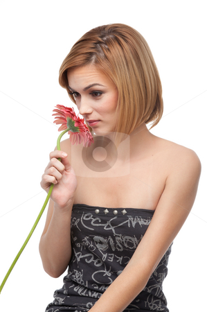 Portrait of a young woman smelling a flower stock photo, A portrait of a young, blonde woman, smelling a red flower and smiling by dan comaniciu