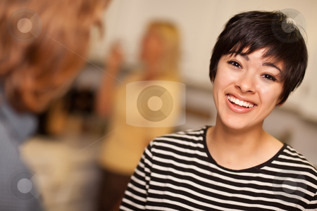 Laughing Young Woman Socializing stock photo, Laughing Young Woman Socializing in a Party Setting. by Andy Dean