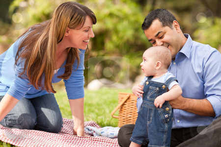 Happy Mixed Race Family Playing In The Park stock photo, Happy Mixed Race Family Having a Picnic and Playing In The Park. by Andy Dean