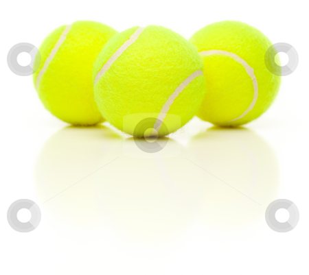 Three Tennis Balls on White with Slight Reflection stock photo, Three Tennis Balls with Slight Reflection Isolated on a White Background. by Andy Dean