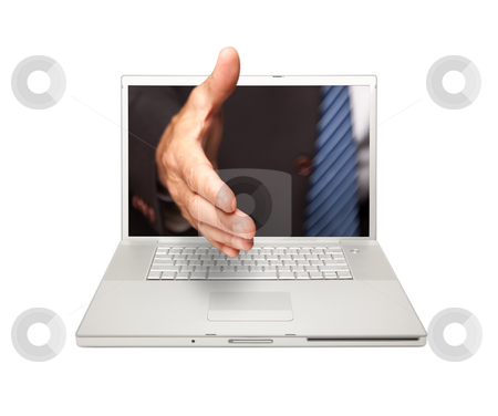 Man Reaching for a Handshake Through Laptop Screen stock photo, Man Reaching for a Handshake Through Laptop Screen Isolated on a White Background. by Andy Dean