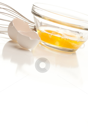 Hand Mixer with Eggs in Glass Bowl stock photo, Hand Mixer with Eggs in a Glass Bowl on a Reflective White Background. by Andy Dean