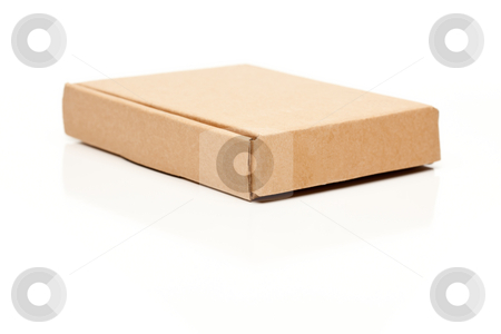 Closed Thin Cardboard Box on White stock photo, Closed Thin Cardboard Box Isolated on a White Background. by Andy Dean