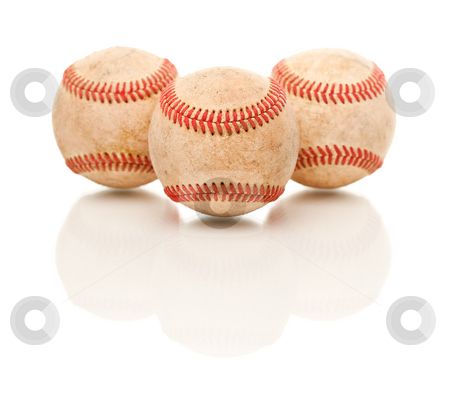 Three Baseballs Isolated on Reflective White stock photo, Three Baseballs Isolated on a Reflective White Background. by Andy Dean