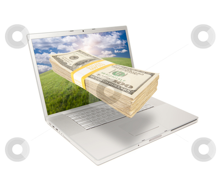 Laptop with Stack of Money Coming From Screen stock photo, Silver Computer Laptop Isolated on White with Stack of Hundred Dollar Bills Extruding the Screen. by Andy Dean
