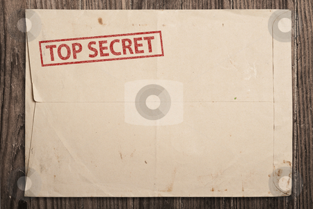 Open top secret envelope on table. stock photo, Open yellow envelope with top secret stamp and papers, on wooden table, clipping path. by Pablo Caridad