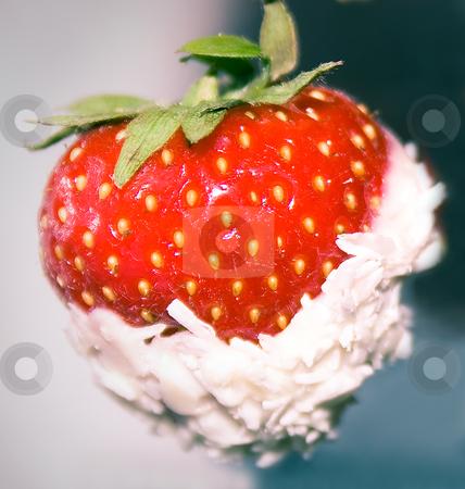 Strawberry stock photo, Strawberry in a sweet coconut glaze close up by Tatjana Keisa