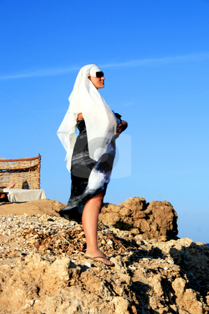 Woman standing on a mountain stock photo, Woman standing on a mountain in Egypt and looking far by Tatjana Keisa