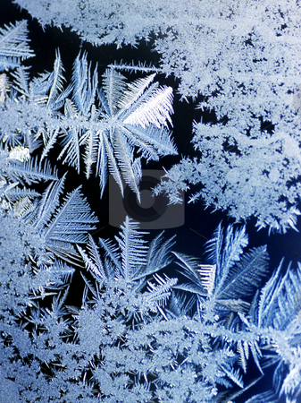 Frost on window stock photo, Frost on a window pane in old farm house by Christian Delbert