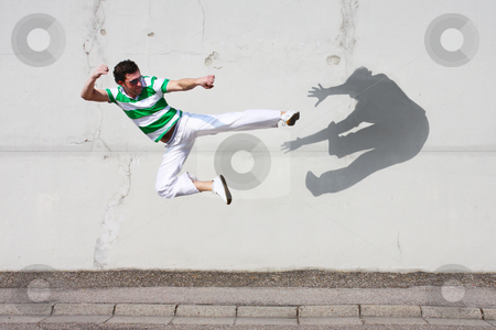 Fight against the own shadow stock photo, Man fighting against his own shadow by Viktor Thaut