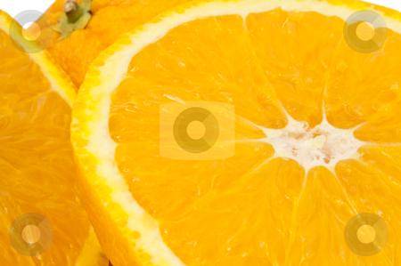 Oranges. stock photo, Close up of freshly cut orange slices. by Samantha Craddock