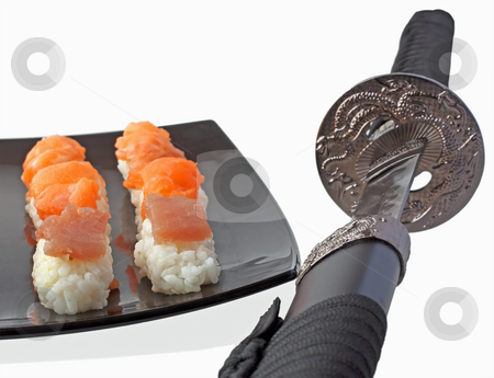 Sword and sushi stock photo, Katana near a black plate with pieces of sushi by Fabio Alcini