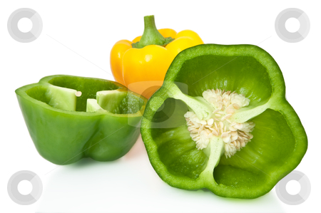 Pepper selection. stock photo, Close and low level capturing a selection of whole and halved bell peppers arranged over white. by Samantha Craddock