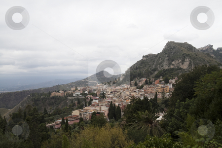 Hill side stock photo, Looking over the overcast hills of Messina, Italy by Kevin Tietz