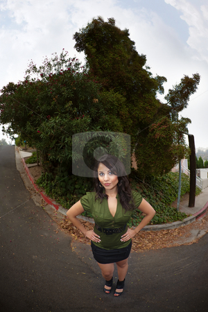 Pretty Latina Woman stock photo, Fisheye Shot of Pretty Latina Woman Standing on Street Outdoors by Scott Griessel