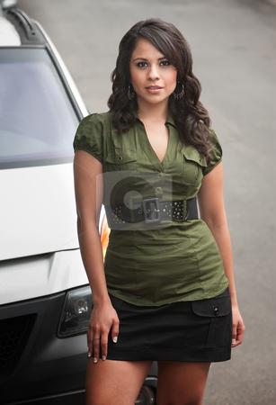 Pretty Hispanic Woman Outdoors stock photo, Pretty Brunette Hispanic Woman Outdoors on Street by Scott Griessel